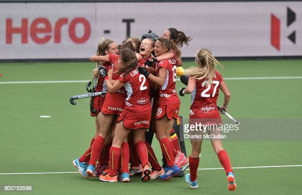Belgium celebrate at the final whistle after defeating New Zealand during the FINTRO Women's Hockey World League SemiFinal Pool B game between...