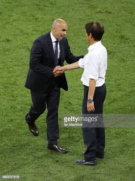 Belgium coach Roberto Martinez and Japan coach Akira Nishino are seen at full time during the 2018 FIFA World Cup Russia Round of 16 match between...
