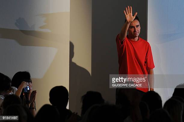 Belgium designer Raf Simons salutes at the end of Jil Sander Spring/Summer 2010 ready-to-wear collection on September 25, 2009 during the Women's...