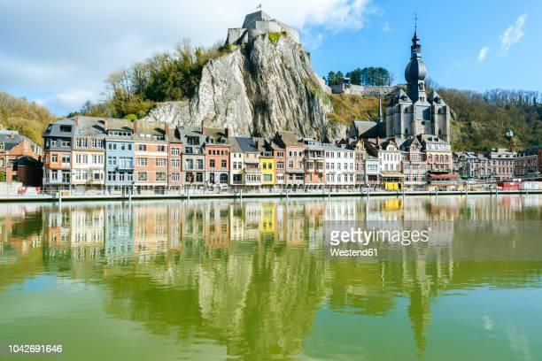 belgium, dinant, cityscape with meuse river - meuse river stock photos and pictures
