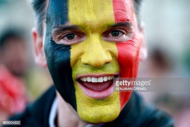 Belgium fan cheers before the Russia 2018 World Cup quarter-final football match between Brazil and Belgium at the Kazan Arena in Kazan on July 6,...