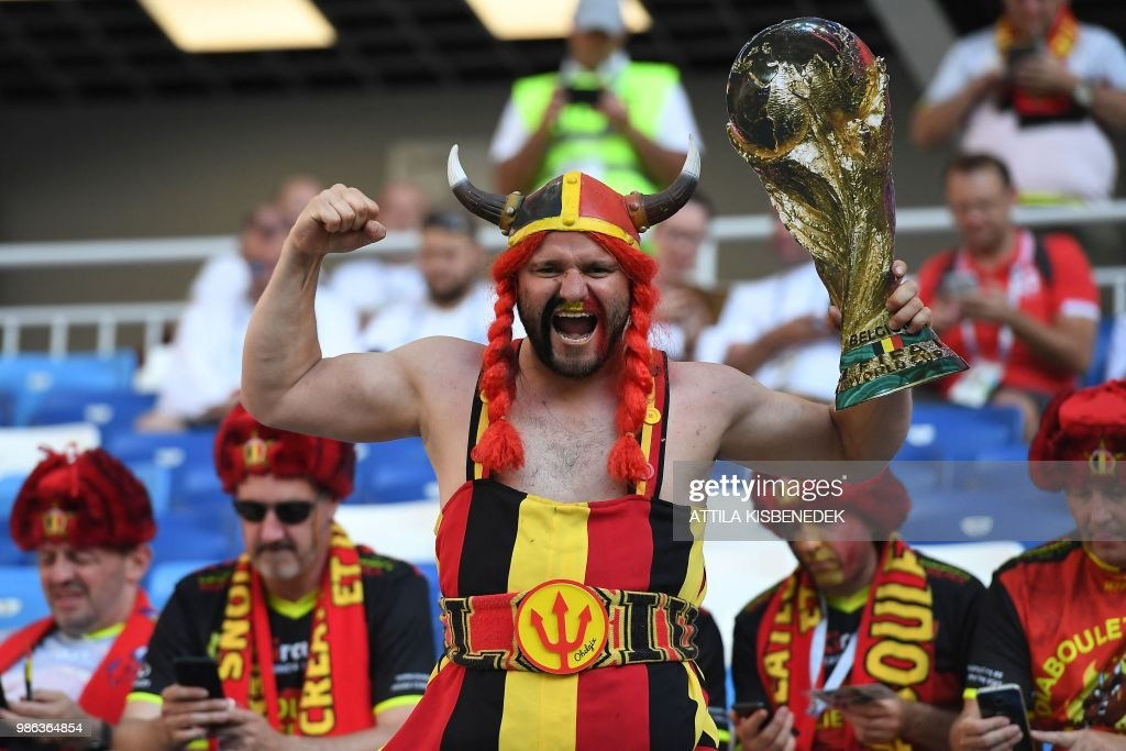 Belgium fan holds a cut-out of the World Cup trophy prior to the Russia 2018 World Cup Group G football match between England and Belgium at the Kaliningrad Stadium in Kaliningrad on June 28, 2018. (Photo by Attila KISBENEDEK / AFP) / RESTRICTED