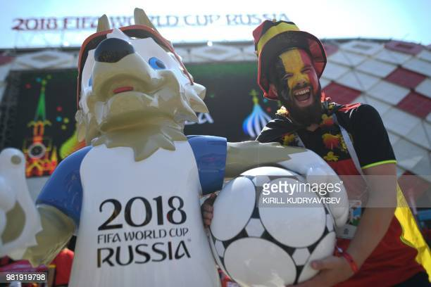 A Belgium fan poses with the Russia 2018 World Cup mascot Zabivaka outside the stadium before the Russia 2018 World Cup Group G football match...