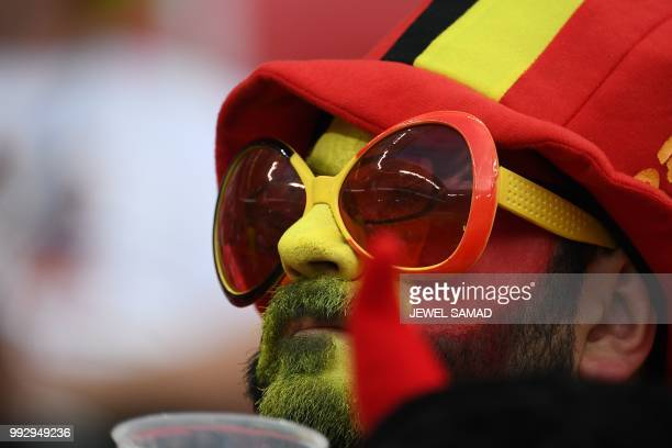 Belgium fan waits for the start of the Russia 2018 World Cup quarter-final football match between Brazil and Belgium at the Kazan Arena in Kazan on...