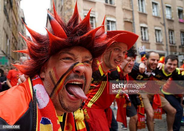 TOPSHOT Belgium fans celebrate in the city of Lyon in eastern France on June 13 prior to their Euro 2016 football match against Italy / AFP /...