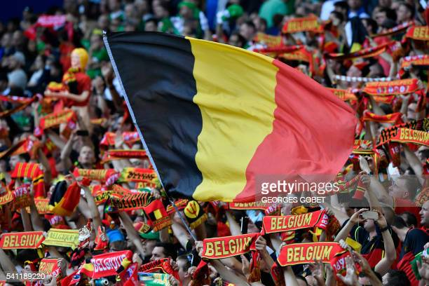 Belgium fans fly their flag during the Euro 2016 group E football match between Belgium and Ireland at the Matmut Atlantique stadium in Bordeaux on...