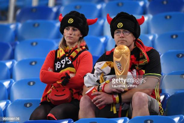 Belgium fans look dejected following their's team defeat in the 2018 FIFA World Cup Russia Semi Final match between Belgium and France at Saint...