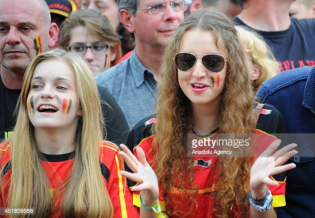 Belgium fans support their team after their team is eliminated from the 2014 FIFA World Cup Brazil Quarter Final match in front of Royal Palace of...