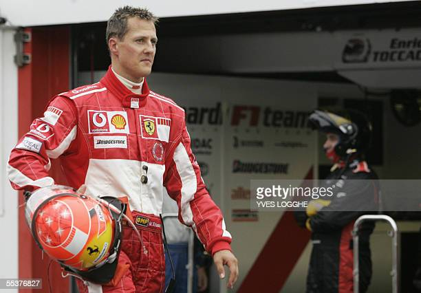 Ferrari German driver Michael Schumacher leaves the SpaFrancorchamps racetrack after he retired from the Belgian Grand Prix 11 September 2005 in...