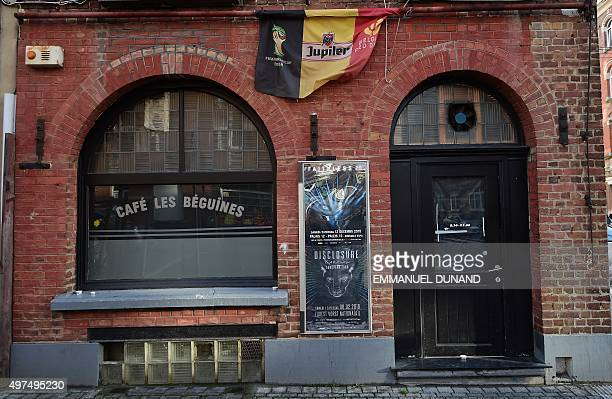 A Belgium flag adorns the front of the bar Les Beguines owned by Brahim Abdeslam one of the suicide bombers implicated in the Paris attacks on...