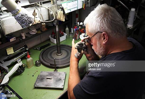 Belgium Flanders Antwerp diamondcutting industry employee is checking a cutted diamond