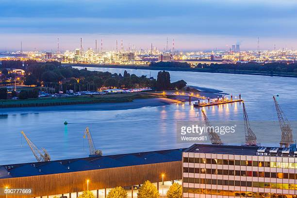 Belgium, Flanders, Antwerp, View to dock area with industrial area at Scheidt river in the evening