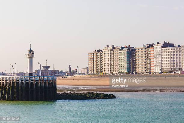 belgium, flanders, ostende, north sea seaside resort, view to light house and beach - オステンド ストックフォトと画像