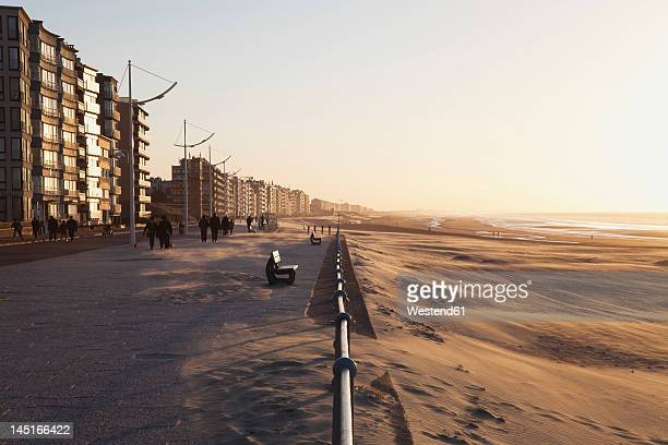 belgium, flanders, people walking along beach - belgium stock pictures, royalty-free photos & images