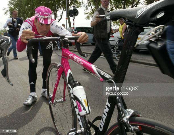 German Erik Zabel checks his handlebar before a training session in front of Post Hotel in Herstal, 01 July 2004 near Liege, two days before the...