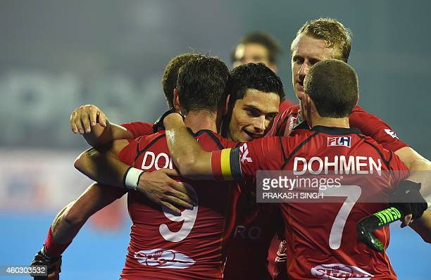 Belgium hockey players celebrate a goal against India during their Hero Hockey Champions Trophy 2014 quarter final match at Kalinga Stadium in...