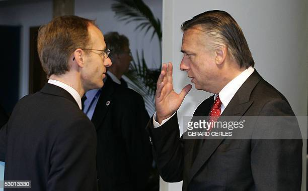 Belgium Interior Minister Patrick Dewael chats with his Luxembourgian counterpart Luc Frieden 03 June 2005 before an EU Home Affairs ministers...