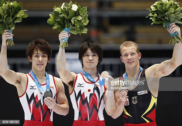 ANTWERP Belgium Japan's Kohei Uchimura holds his gold medal on the podium after becoming the first gymnast in history to win four consecutive men's...