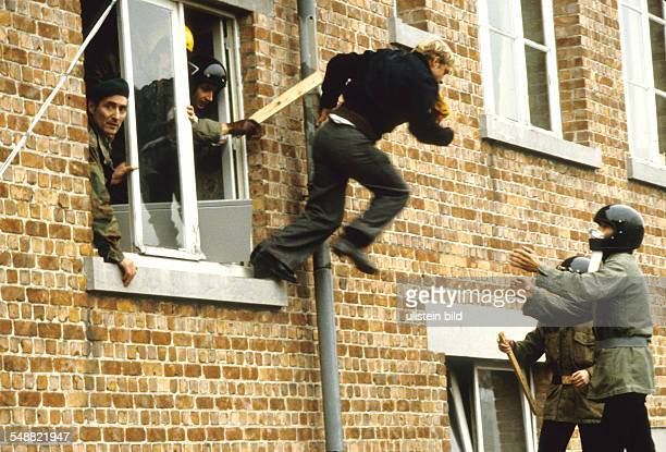 Belgium: Members of the VMO try to escape from the police.