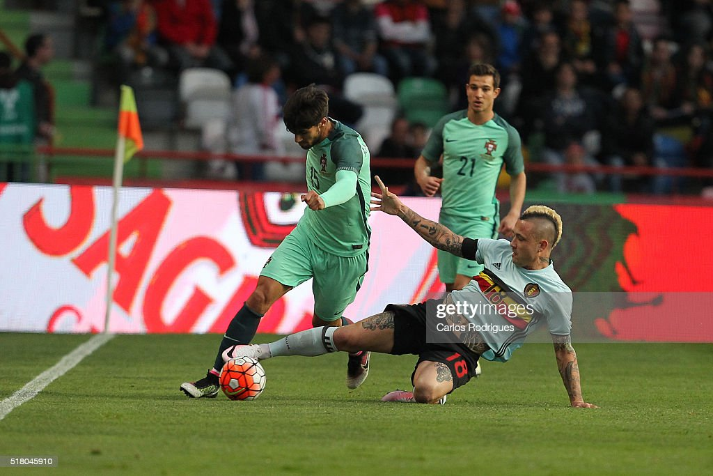 Belgium midfielder Nainggolan tackles Portuguese midfielder Andre Gomes during the match between Portugal and Belgium Friendly International at Estadio Municipal de Leiria on March 29, 2016 in Lisbon, Portugal.