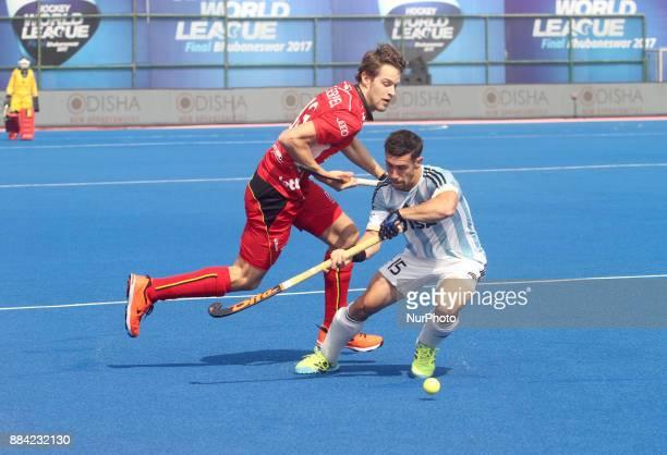 Belgium players DE KERPEL Nicolas competes against PAZ Diego of Argentina during Odisha Men's Hockey World League Final between Belgium and...