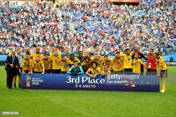 Belgium players pose for a photo after receiving their third place medals during the 2018 FIFA World Cup Russia 3rd Place Playoff match between...