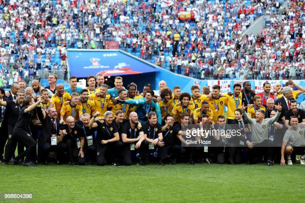 Belgium players pose for a photo after recieving their third place medals during the 2018 FIFA World Cup Russia 3rd Place Playoff match between...