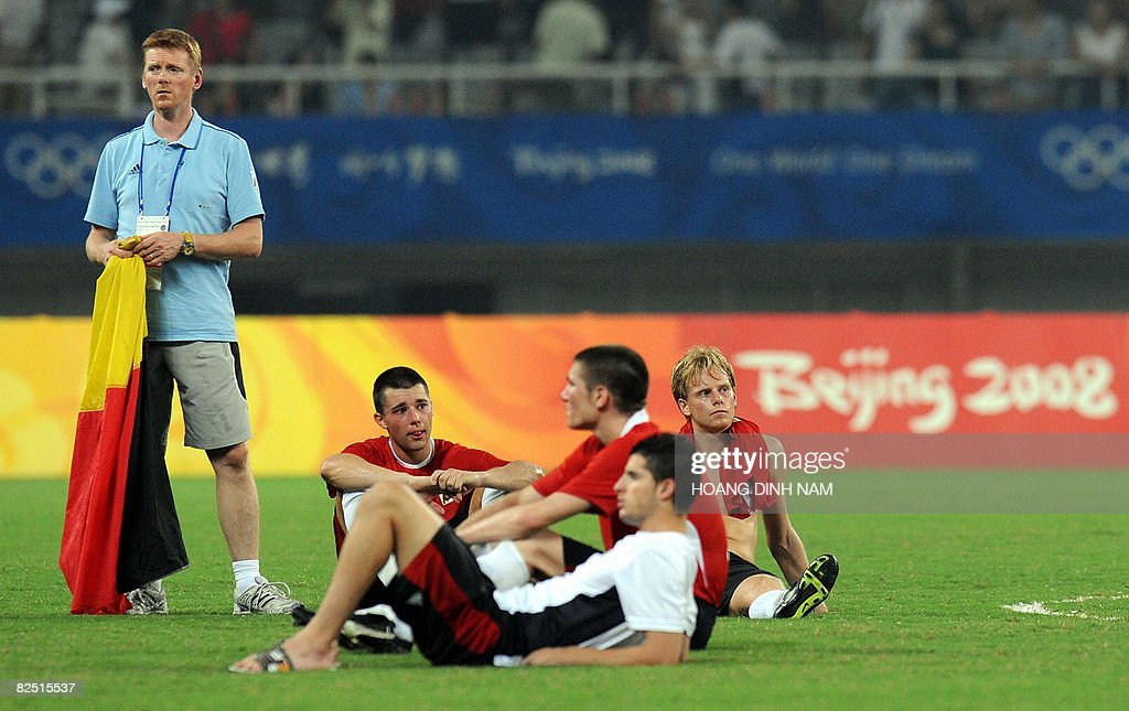 Belgium players react after losing 0-3 to Brazil during the 2008 Beijing Olympic Games men's football bronze medal match in Shanghai on August 22, 2008. AFP PHOTO/HOANG DINH Nam