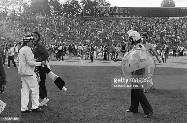 A Belgium policeman faces fans on May 29 1985 in Heysel stadium in Brussels as violence has broken out one hour before the European Champion Clubs...