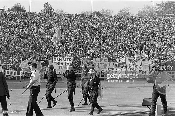 Belgium policemen face British fans on May 29 1985 in Heysel stadium in Brussels as violence has broken out one hour before the European Champion...