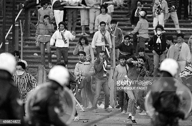 Belgium policemen face Italian fans on May 29 1985 in Heysel stadium in Brussels as violence has broken out one hour before the European Champion...