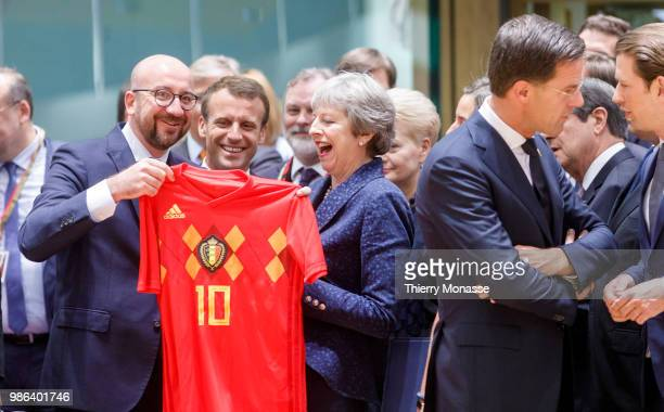 Belgium Prime Minister Charles Michel is giving a Belgium national football team of Eden Hazard to the Prime Minister of the United Kingdom Theresa...