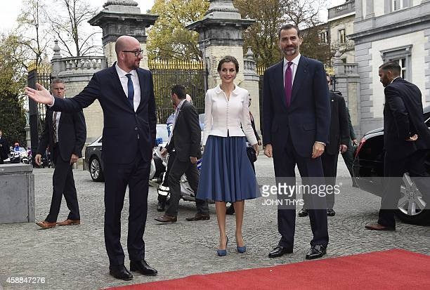 Belgium Prime Minister Charles Michel Spanish King Felipe VI and Spanish Queen Letizia pose during an official welcoming ceremony at the Egmont...