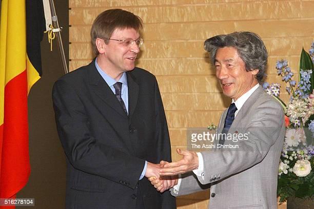 Belgium Prime Minister Guy Verhofstadt and Japan Prime Minister Junichiro Koizumi shake hands prior to their meeting at Koizumi's official residence...