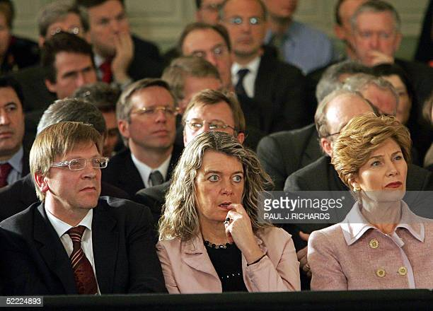 Belgium Prime Minister Guy Verhofstadt his wife Dominique Verkinderen and US First Lady Laura Bush listen as US President George W Bush delivers...
