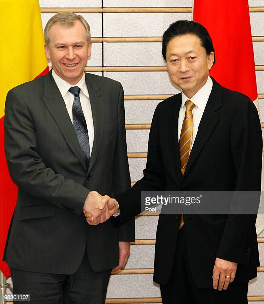 Belgium Prime Minister Yves Leterme left is welcomed by Japanese Prime Minister Yukio Hatoyama prior to their talks at Hatoyama's official residence...