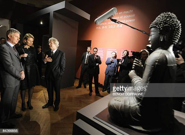 Belgium Prince Philippe Princess Mathilde and Exhibition commissioner Jan Van Alphen chat as they paid a visit to the exhibition 'Le sourire de...