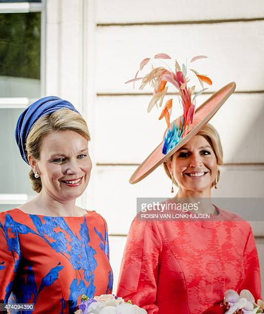 Belgium Queen Mathilde and Dutch Queen Maxima attend the opening of exhibition Vormidable in The Hague on May 20 displaying contemporary Flemish...