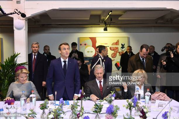 Belgium royal couple Philippe of Belgium and Mathilde of Belgium French President Emmanuel Macron his wife Brigitte Macron sit at the cultural center...
