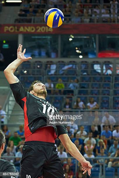 Belgium Simon Van De Voorde spikes the ball during the FIVB World Championships match between Belgium and Iran at Cracow Arena on September 6, 2014...