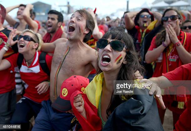 Belgium soccer fans react as their team misses a scoring opportunity as their team plays against Russia on a screen setup at the FIFA Fan Fest on...