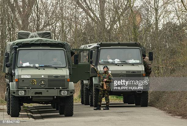 Belgium soldiers carry out a search operation in the Rodenburg neighbourhood in Kortrijk in west Flanders on March 31 2016 Belgian security on March...