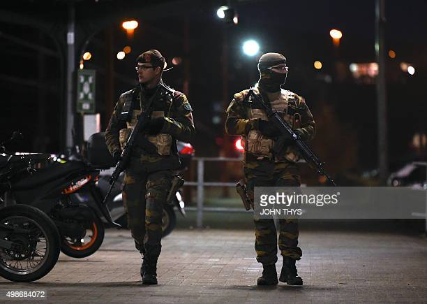 Belgium soldiers patrol near a railways station in Vervier on November 25 2015 Brussels struggled to return to normal on November 25 after four days...