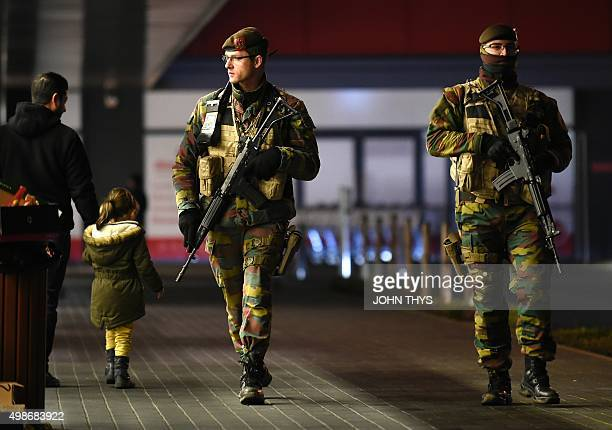 Belgium soldiers patrol near the Crescend'eau shopping center in Vervier on November 25 2015 Brussels struggled to return to normal on November 25...