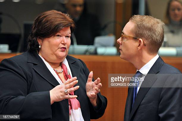 Belgium State Secretary for Migration and Asylum Policy Maggie De Block and Swedish Minister of Migration and Asylum Policy Tobias Billstrom talk...