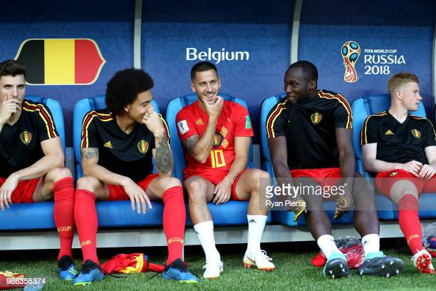 Belgium substitutes Axel Witsel Eden Hazard Romelu Lukaku and Kevin De Bruyne look on prior to the 2018 FIFA World Cup Russia group G match between...