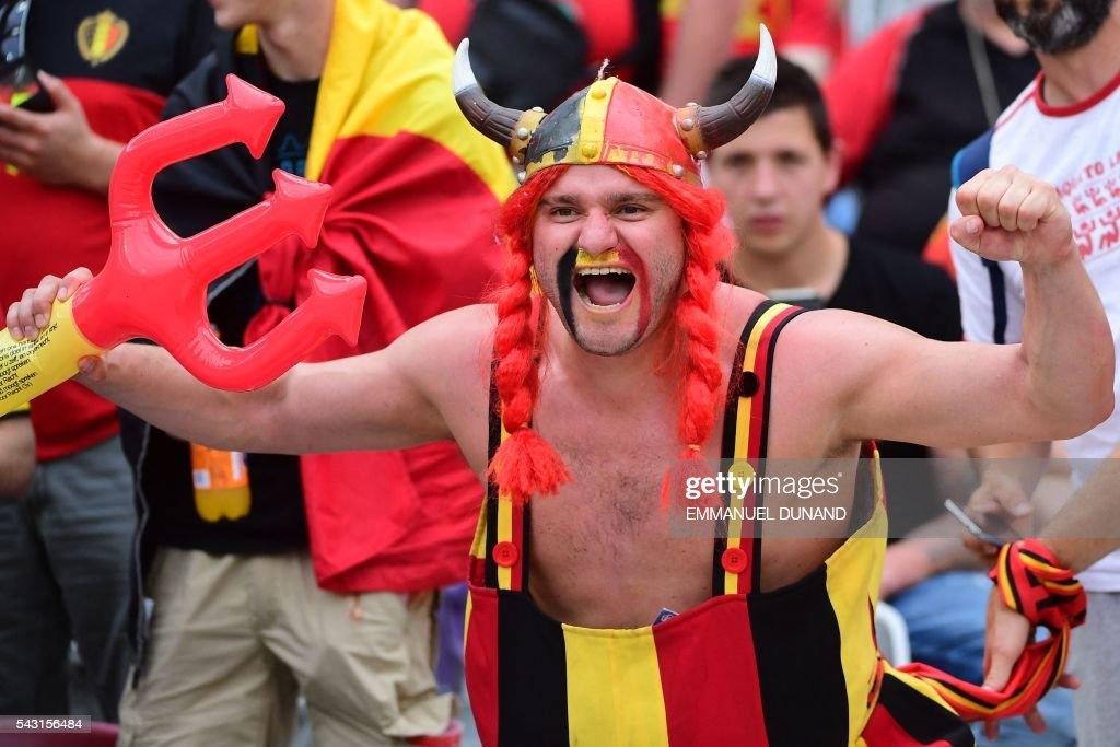 A Belgium supporter cheers prior to the Euro 2016 round of 16 football match between Hungary and Belgium at the Stadium Municipal in Toulouse on June 26, 2016. / AFP / EMMANUEL