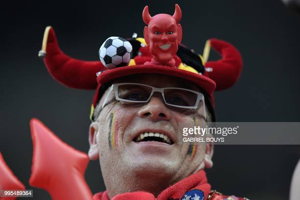 Belgium supporter poses for a picture ahead of the Russia 2018 World Cup semifinal football match between France and Belgium at the Saint Petersburg...