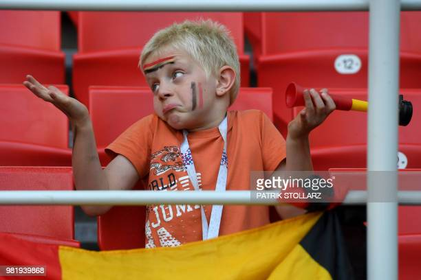 Belgium supporter reacts during the Russia 2018 World Cup Group G football match between Belgium and Tunisia at the Spartak Stadium in Moscow on June...