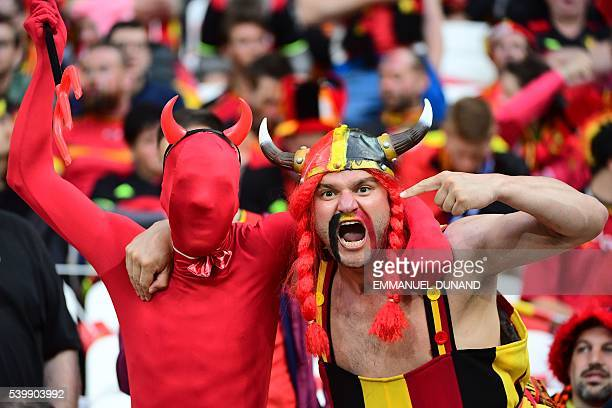 TOPSHOT Belgium supporters cheer for their team ahead of the Euro 2016 group E football match between Belgium and Italy at the Parc Olympique...